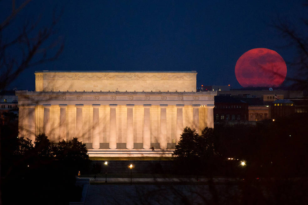 "The full moon is seen as it rises near the Lincoln Memorial, Saturday, March 19, 2011, in Washington. The full moon tonight is called a ""Super Perigee Moon"" since it is at it's closest to Earth in 2011. The last full moon so big and close to Earth occurred in March of 1993. Photo Credit: (NASA/Bill Ingalls)"